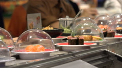 Rotating sushi, conveyor belt, fresh dishes, Japanese restaurant, Taipei, Asia Stock Footage