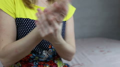 Woman uses hand cream Stock Footage