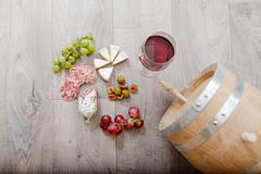 Still life with red wine and excellent food. - stock photo