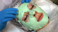 Doctor making off cosmetic mask on face Stock Footage