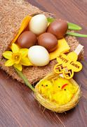 Easter decoration and fresh spring narcissus flowers. - stock photo