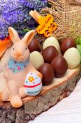 Easter decoration  bunny with chocolate eggs. Stock Photos