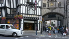Driving and walking by the Liberty shopping mall in London Stock Footage