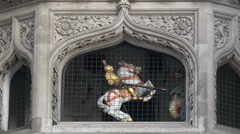Knight with dragon rotating inside a clock in London Stock Footage