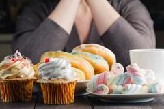 Many sweets and donuts - stock photo
