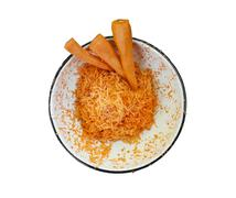 Grated carrots in the dish. - stock photo