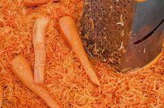 Grated carrots on the table. - stock photo