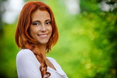 portrait of redhead brunette - stock photo