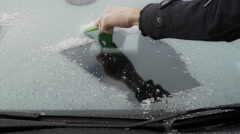 Male Scraping Ice Off A Car Windscreen Stock Footage