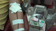 A man of Chinese ethnicity donates blood inside a bus in Taipei, Taiwan Stock Footage