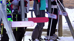 Skiers at ski lift entrance gate waiting in queue line, 4k closeup Stock Footage
