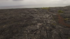 Flying over of lava rock field in Hawaii Stock Footage