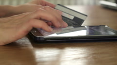 Woman is shopping on line with tablet pc, close up HD Stock Footage
