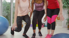 4K Happy friends take a break & chat together during exercise class Stock Footage