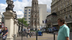 Eleanor Cross in Charing Cross station forecourt, London Stock Footage