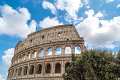 Colosseum View with Trees - stock photo