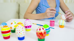 Woman paints on Easter egg Stock Footage