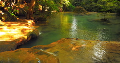 Calm and peaceful scene of tranquil water stream of shallow river flows slowly  Stock Footage
