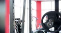 Motivated sportswoman squatting with heavy barbell on shoulders, active workout HD Footage