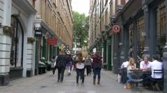 People walking on St Martin's Lane in London - stock footage