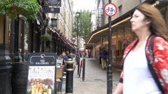 Walking and relaxing on Saint Martin's Lane in London Stock Footage