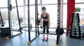 Strong woman doing barbell exercise, female bodybuilder training before contest HD Footage