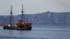 Greece santorini island, vintage cruise with greek flag on the stern boat Stock Footage