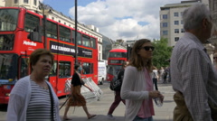 Sightseeing tour buses parked in front of the Charing Cross Station, London Stock Footage