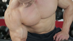 Strong muscular guy exercising in the gym, sports nutrition, active lifestyle - stock footage