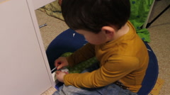 Little Boy Building A Self Assembled Wardrobe - stock footage