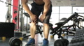 Slow-mo shot of male athlete touching knees, suffering sharp pain after injury HD Footage