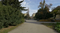 Stock Video Footage of Woman pushing a baby stroller in park Zrinjevac, Zagreb