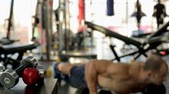 Active atmosphere in gym, defocused people training, healthy nutrition, sport - stock footage