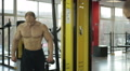 Professional bodybuilder with perfect muscular body working out in the gym HD Footage