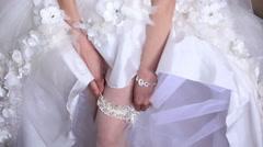 Beautiful sexy bride slowly wearing white lace bandage - stock footage