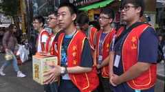 Asia volunteering, charity, good cause, students, donate, Taipei streets Stock Footage