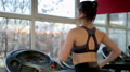 Active young woman exercising on treadmill, training hard to have fit body Footage
