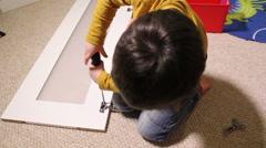 Little Boy Building A Self Assembled Wardrobe Stock Footage