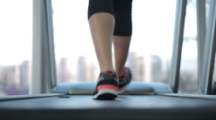 Back view of female legs walking and running on treadmill in gym, woman training Arkistovideo