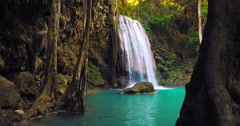 Amazing nature of Thailand rainforest national park. Waterfall flows in pond Stock Footage