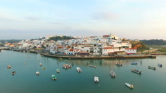 Aerial from the village Ferragudo in the Algarve Portugal at sunset Stock Footage