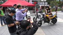 Asian sexy femaile model poses for photographers on motorbike Stock Footage