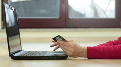 Woman's hands holding a credit card and using laptop computer HD Stock Footage
