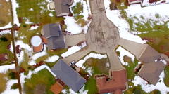 Aerial looking straight down on middle-class neighborhoods, some snow Stock Footage
