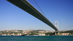 Cruising under suspension bridge. Bosphorus Sea, Istanbul, Turkey.  Stock Footage