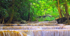 Relaxing scenic nature 4K background. Waterfall cascades in wild tropical forest Stock Footage