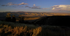 Overlooking a vast valley in the open range of the American West as the sunsets Stock Footage