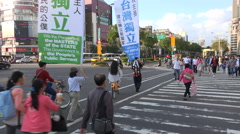 Political activists carry banners for an independent Taiwan through Taipei - stock footage