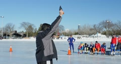 Man fires starting pistol at Speed Skating sprint  in Edmonton, Canada. Stock Footage