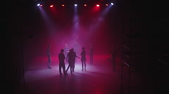 Rehearsal Dance on a Red Background in the Shade on the Set Stock Footage